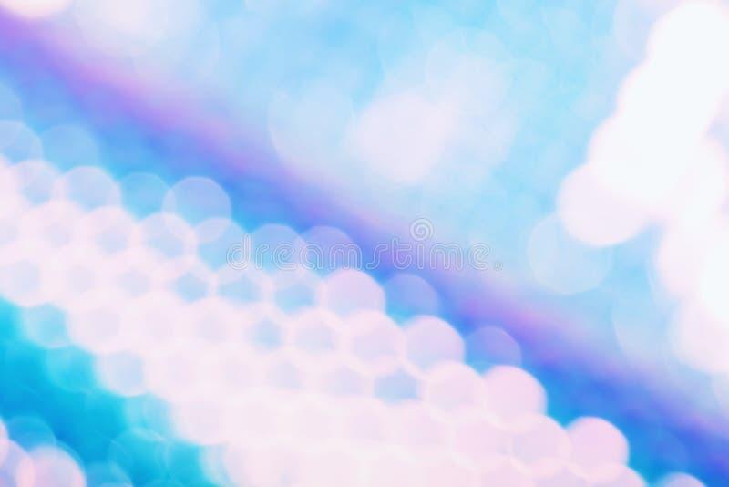 与时髦holo颜色样式和闪耀的bokeh光线影响的全息照相的箔背景 库存图片