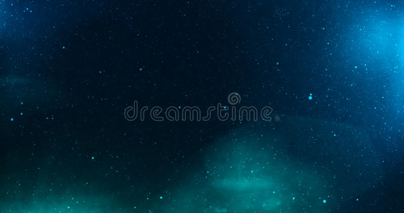 与星和深深蓝色和绿灯的宇宙 免版税库存照片
