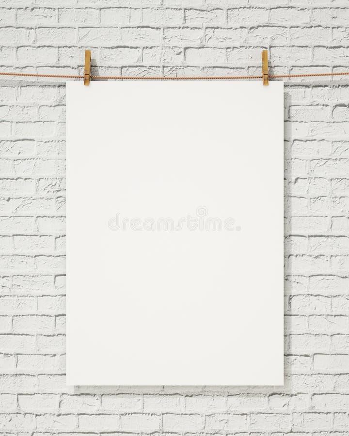 与晒衣夹的空白的白色垂悬的在砖墙,背景上的海报和绳索 库存图片