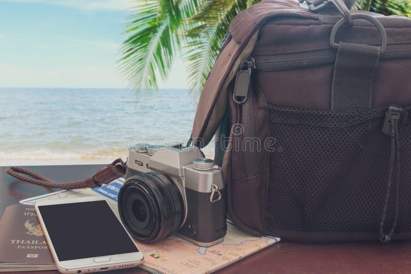与智能手机和护照的照片照相机 图库摄影