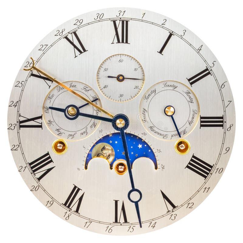 与月亮自转的古色古香的银色时钟表盘 库存照片