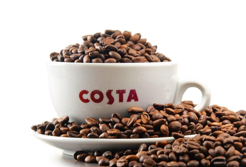 与杯子的构成肋前缘咖啡咖啡和豆 免版税库存图片