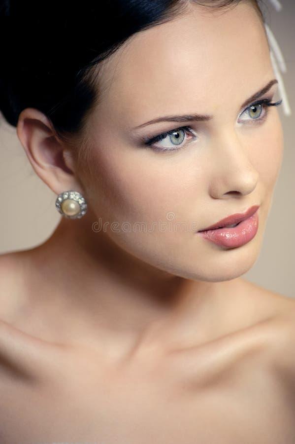 与构成的美丽的女性面孔 免版税库存照片
