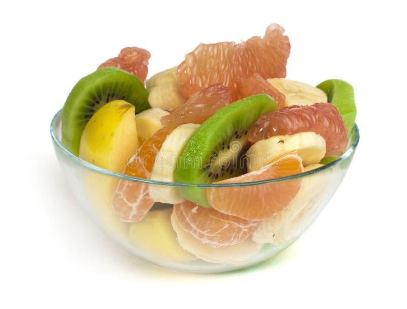 与柑橘的水果沙拉在一个玻璃碗 免版税库存图片