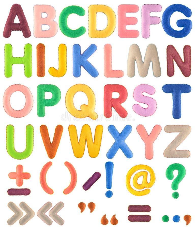与标点符号的手工制造多色字母表集合从毛毡 免版税库存照片
