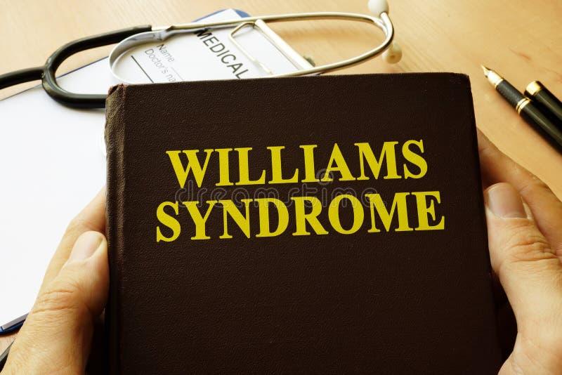 与标题威廉斯综合症状的书 库存照片