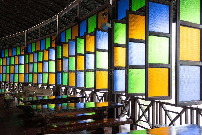 与样式的五颜六色的玻璃窗在玻璃 库存图片