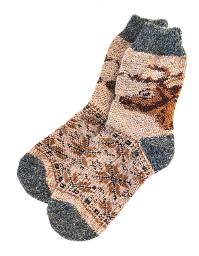 与样式的被编织的圣诞节袜子 在白色背景隔绝的人` s温暖的袜子 免版税库存照片
