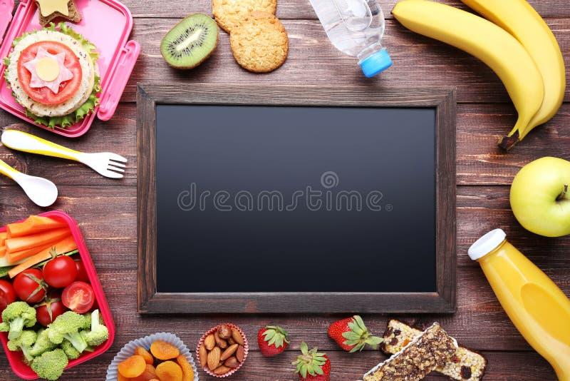 与框架的学校午餐 免版税库存图片