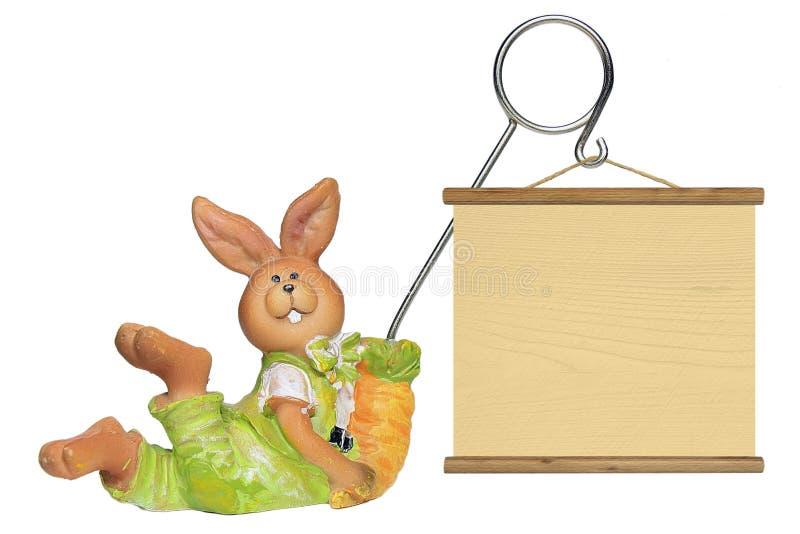与桌的复活节彩蛋兔子 向量例证