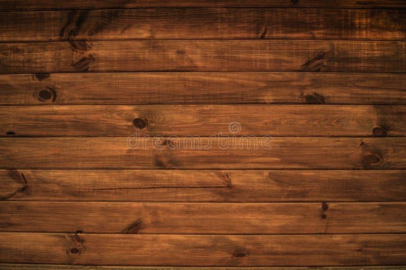 与棕色颜色水平的木板一个美好的结构的背景  免版税库存照片