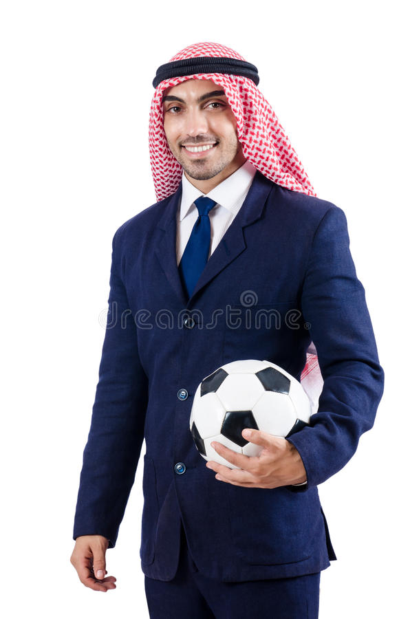 与橄榄球的阿拉伯商人 库存照片