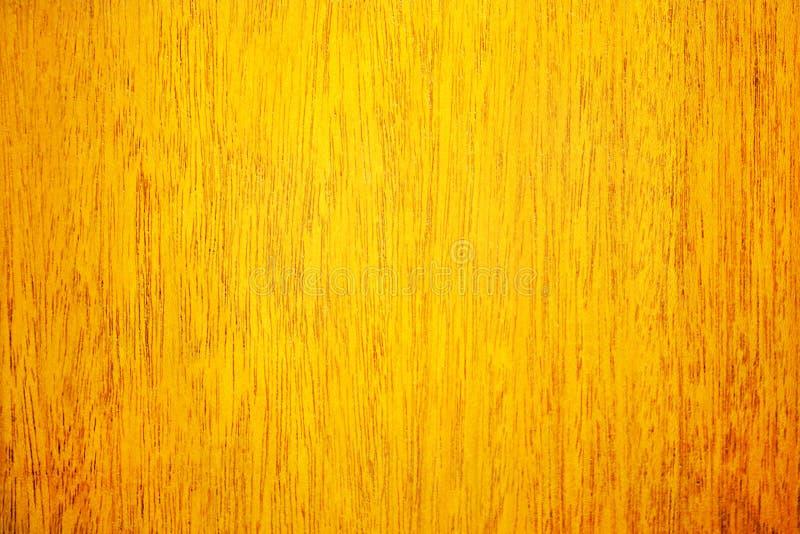 与橙色表面和自然样式的木背景 库存图片