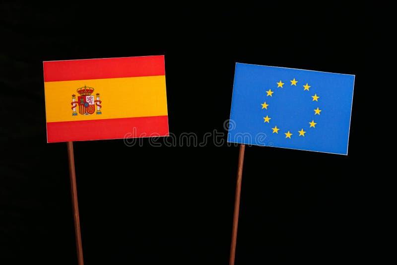 与欧盟欧盟旗子的西班牙旗子在黑色 免版税库存图片