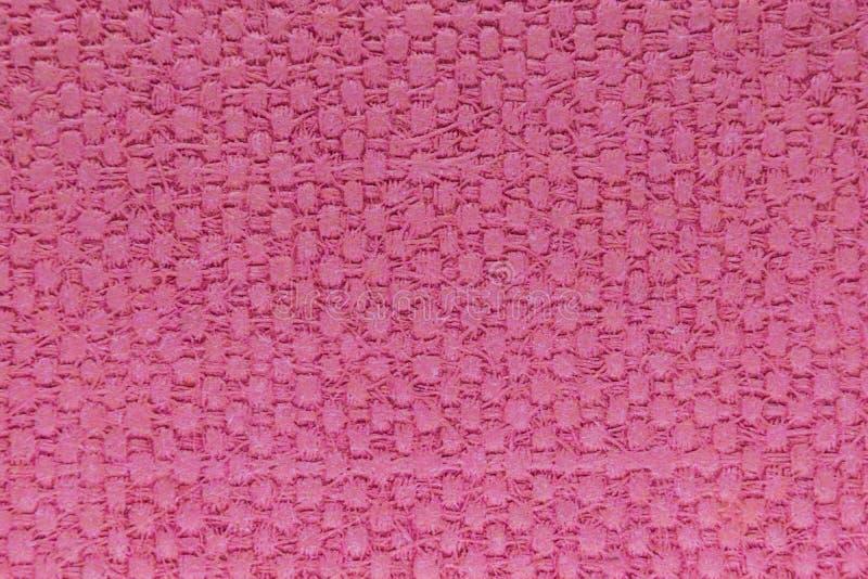 与正方形样式的桃红色塑料背景表面 库存图片