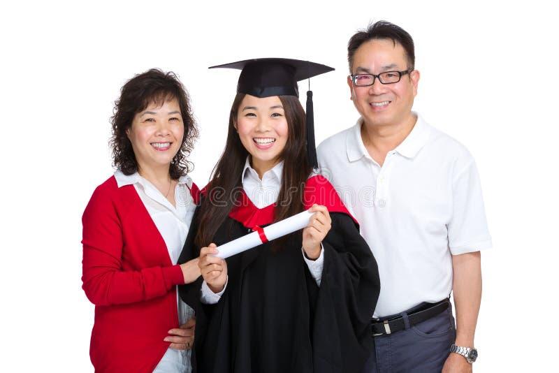 与毕业生女儿的愉快的家庭 库存照片