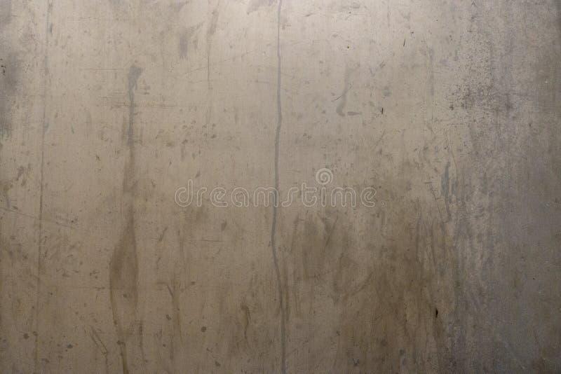 与水位标记的困厄的金属背景表面 免版税库存照片