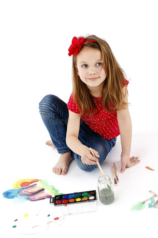 与水彩的小女孩绘画 免版税图库摄影