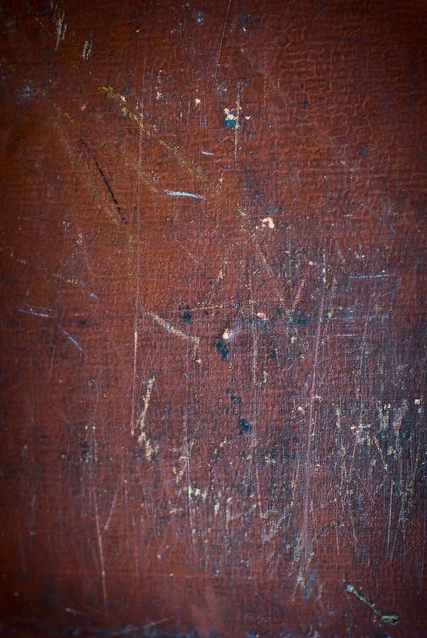 与污点的抽象棕色纹理,抓和与年龄的磨损 在表面的边缘的渐晕 多彩多姿的磨损和 免版税库存图片