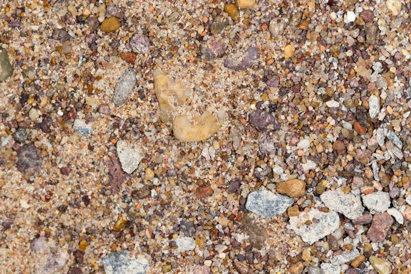 与沙子的石渣作为背景 免版税图库摄影