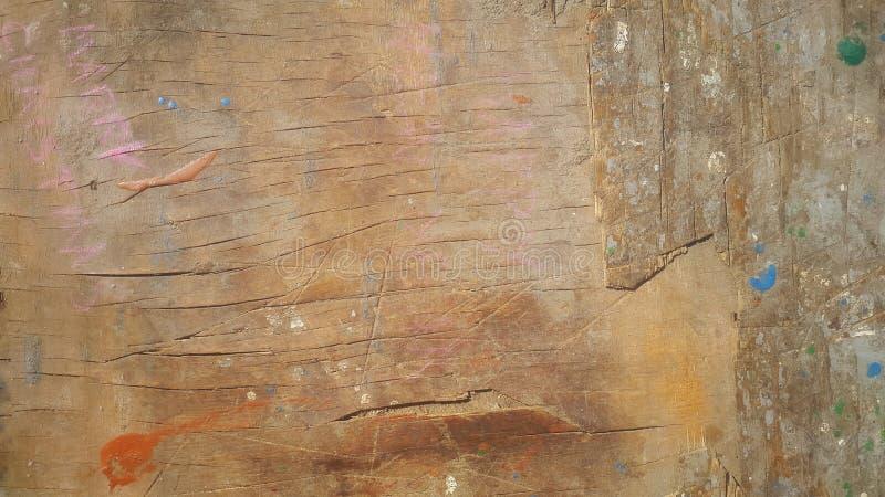 与油漆下落的抽象木纹理  库存照片