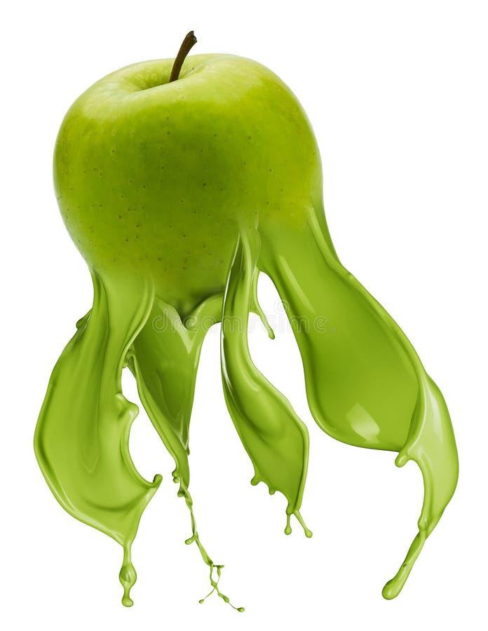 与油漆飞溅的绿色苹果 免版税库存照片