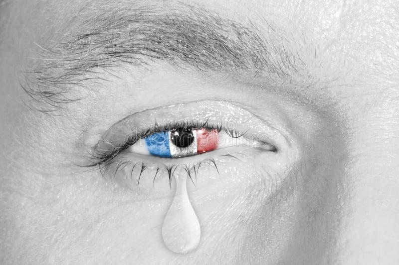 与法国旗子的哭泣的眼睛 库存图片