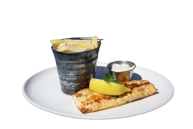 与法语的烤鲈鱼服务在桶油煎了 免版税库存照片