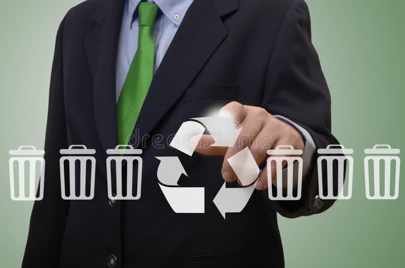 商人感人的触摸屏幕-回收标志 免版税库存照片