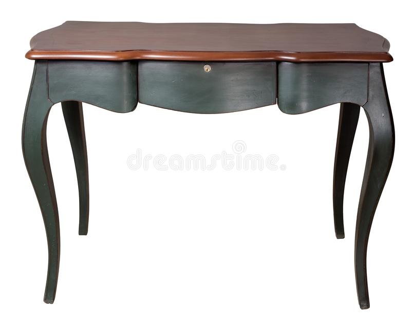 与深绿在白色背景隔绝的腿和三个抽屉的减速火箭的木书桌桌包括裁减路线 库存图片
