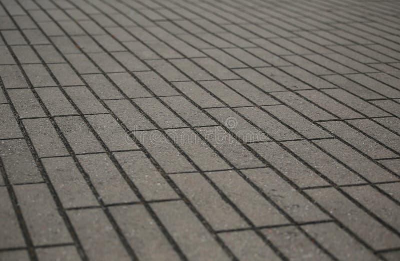 与清楚的线的灰色狭窄的长方形瓦片特写镜头 免版税库存照片