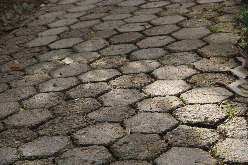 与灰色和对称石头的地面 免版税库存照片