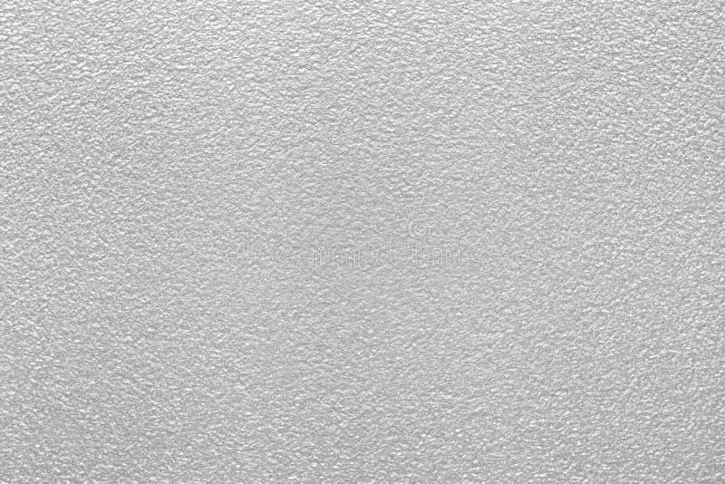 与灰色银色表面效应的织地不很细纸背景 库存照片