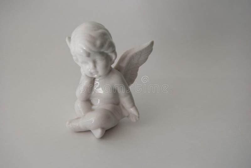 与灼烧的蜡烛的天使形象 库存照片