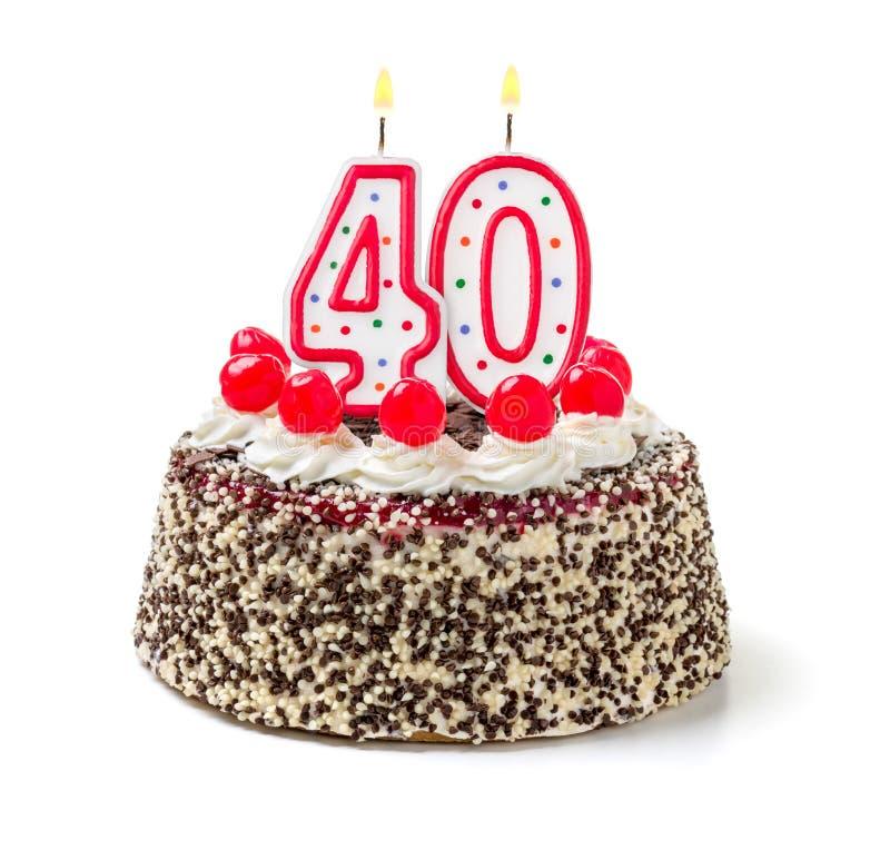 与灼烧的蜡烛第40的蛋糕 库存照片