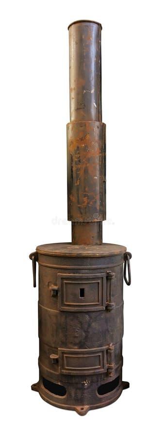 与烟囱的老生锈的火炉 免版税库存图片