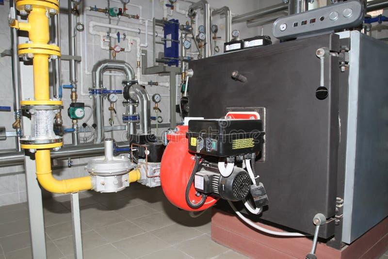 与煤气喷燃器的锅炉 库存照片