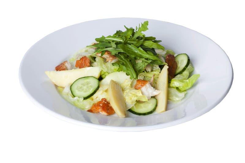 与熏制的鱼,卷心莴苣的沙拉和 免版税库存照片