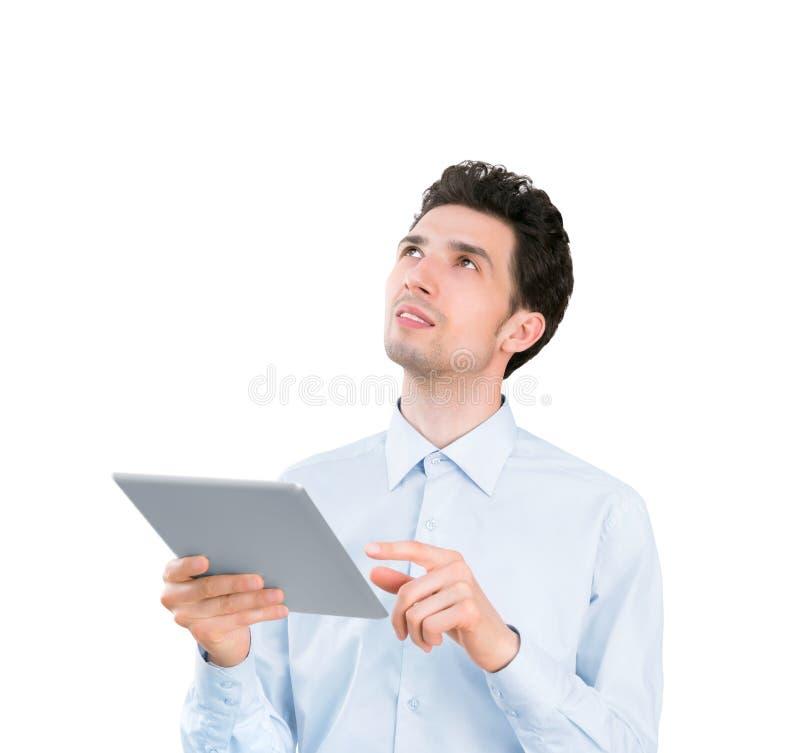 与片剂计算机的年轻商人 库存照片