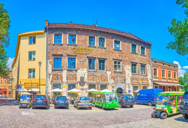 与犹太餐馆的老豪宅在克拉科夫,波兰 免版税库存图片