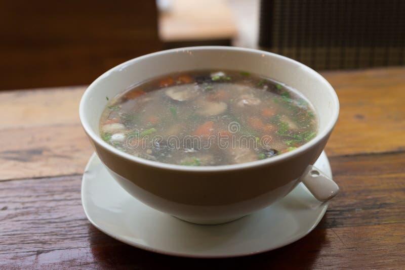 与猪肉混合的米鞠躬,蘑菇 免版税库存照片