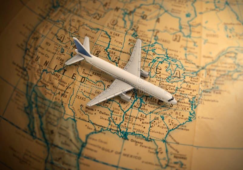 与玩具喷气机班机的地球 库存图片