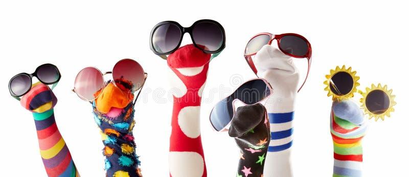 与玻璃的袜子木偶反对白色背景 免版税库存图片