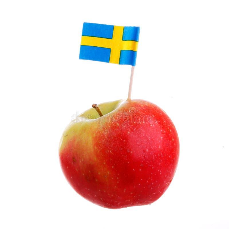与瑞典旗子的苹果计算机 免版税库存图片