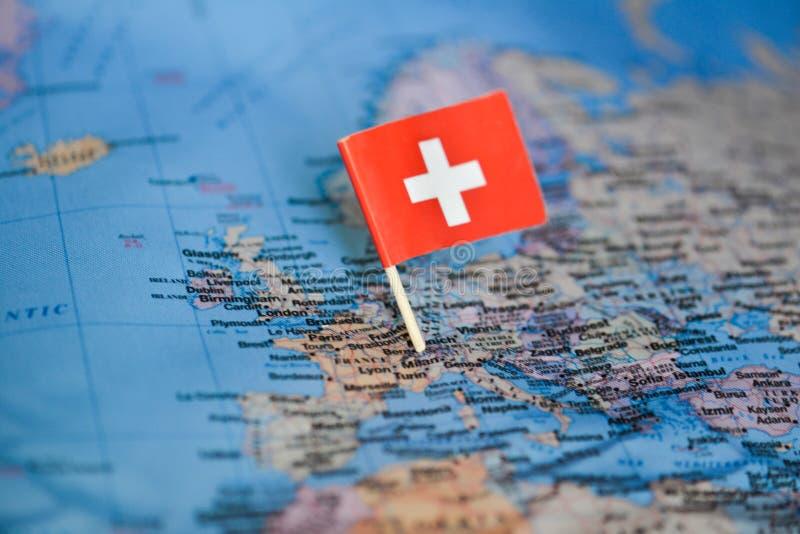 与瑞士的旗子的地图 库存照片