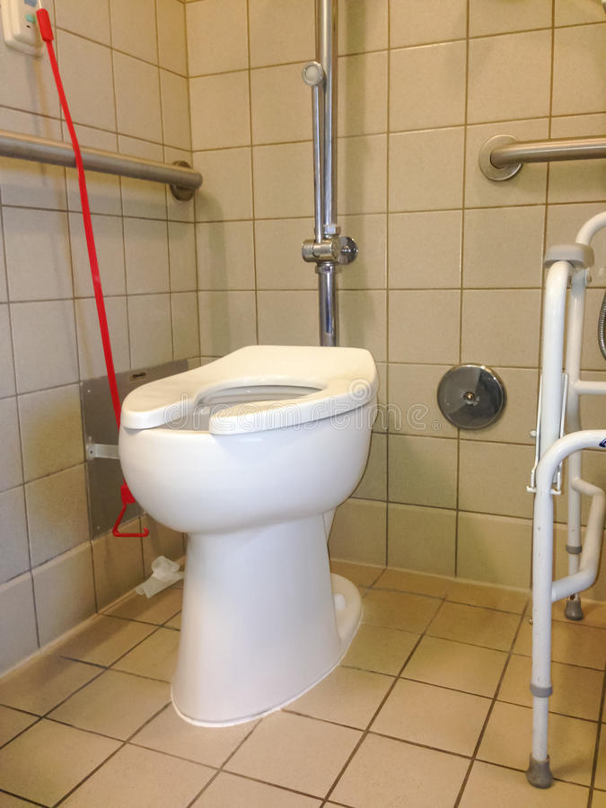 与电话为协助响铃的医院洗手间 免版税库存照片