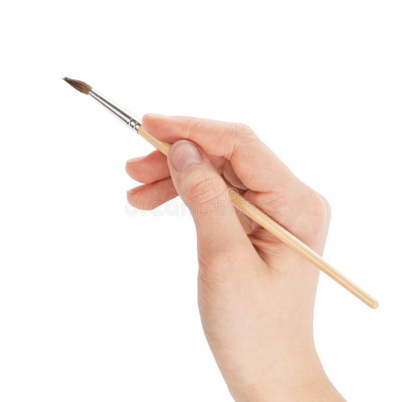 与画笔的女性青少年的现有量 免版税库存照片