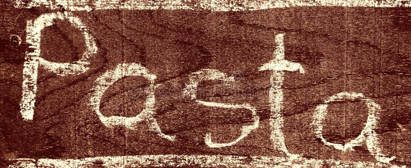 与白垩的手写的题字面团 库存图片