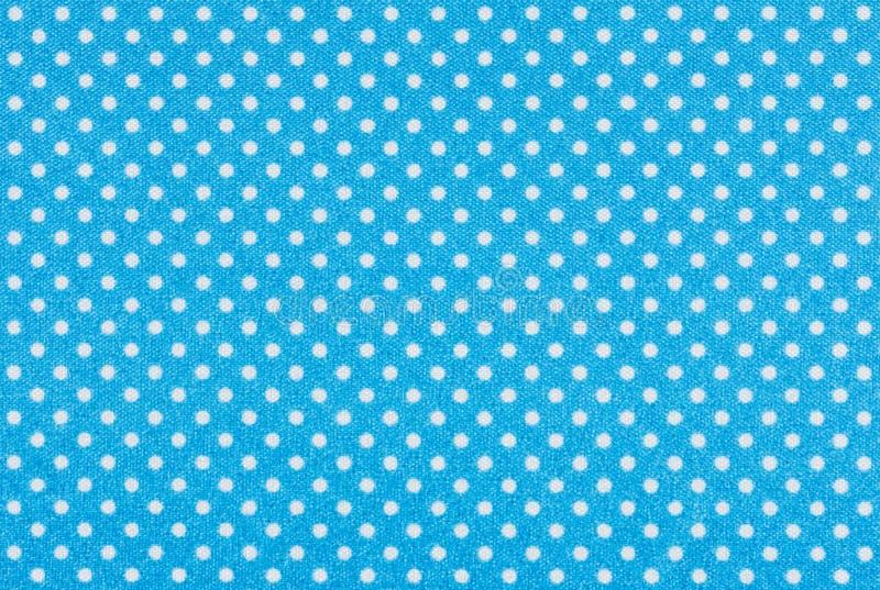 与白色圆点的蓝色织品 库存照片