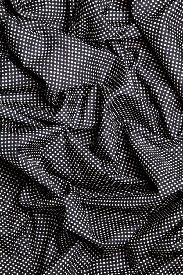与白色小点的黑棉织物设计纹理 重叠的小条 背景 免版税库存照片